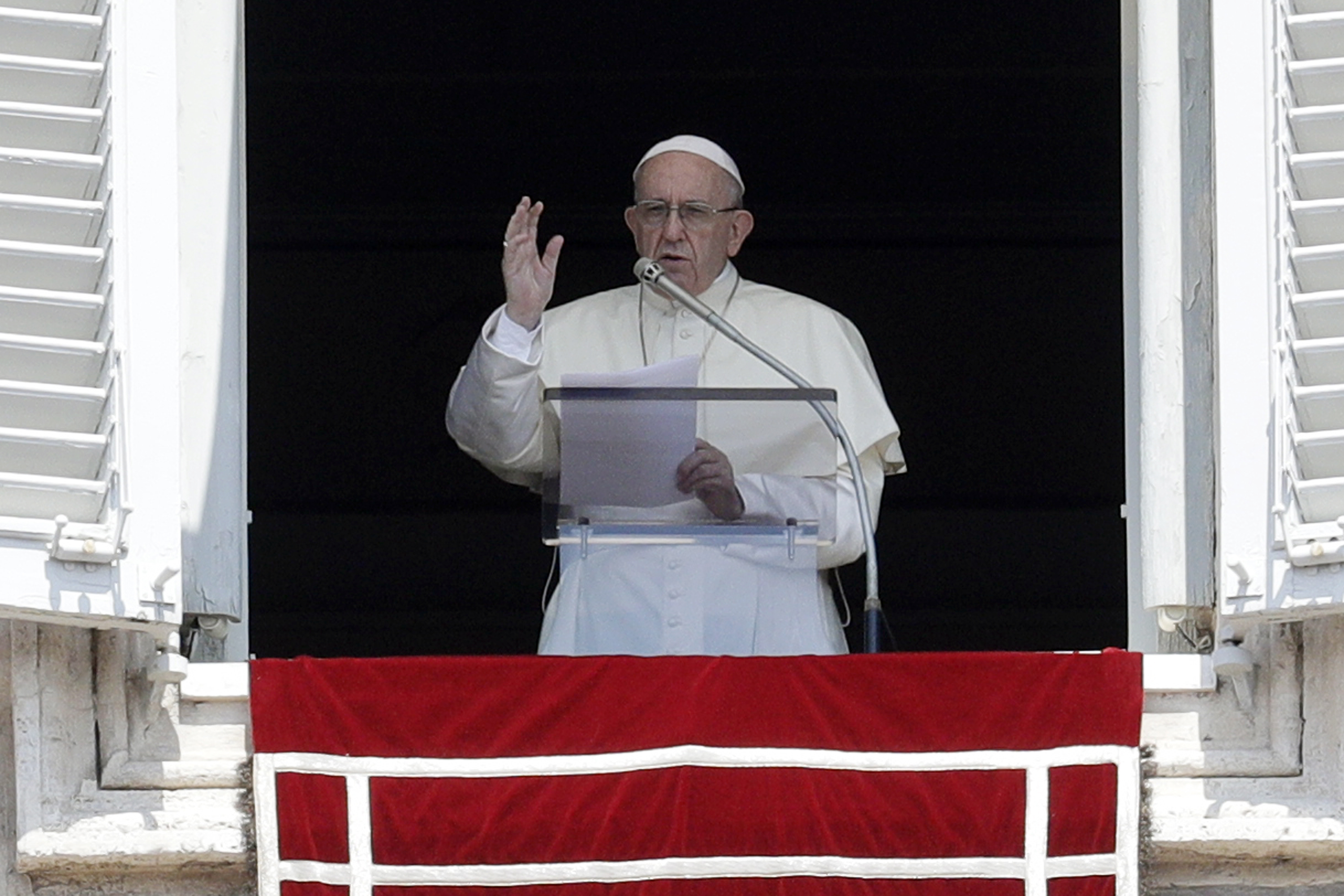 """In this Aug. 5, 2018, file photo Pope Francis delivers a blessing from his studio window overlooking St. Peter's Square at the Vatican. Pope Francis' decree that the death penalty is """"inadmissible"""" in all cases could pose a dilemma for Roman Catholic politicians and judges in the United States. Some Catholic leaders in death penalty states have said they'll continue to support capital punishment, despite the change in church teaching. (Gregorio Borgia/AP)"""