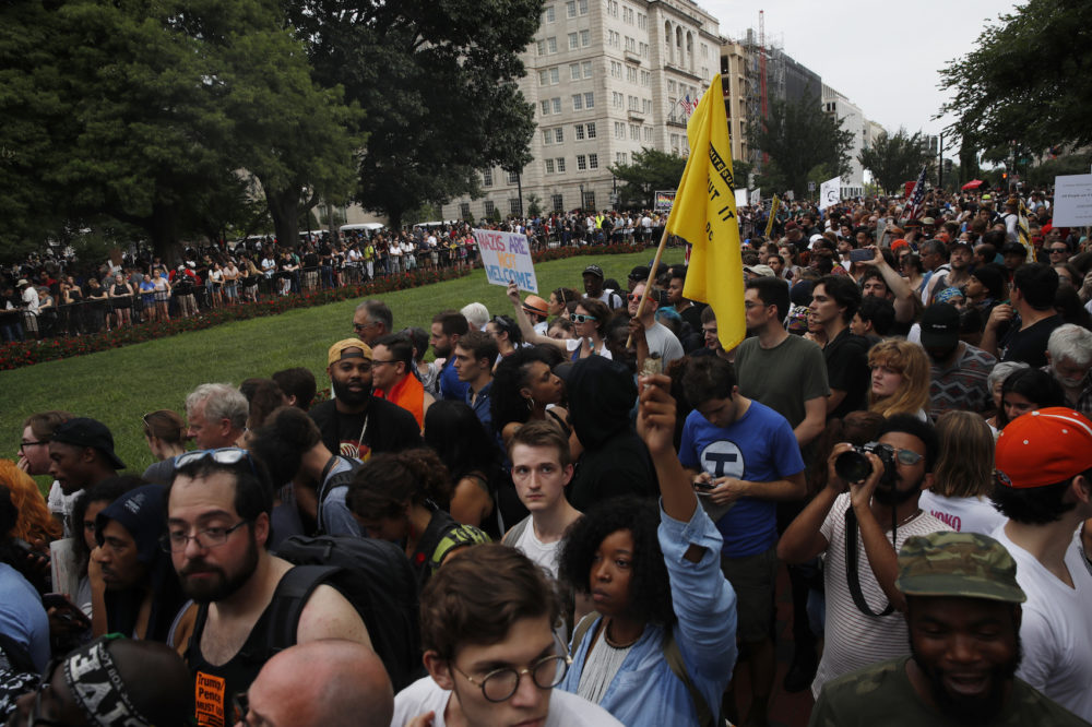 "Demonstrators march near the White House on the one year anniversary of the Charlottesville ""Unite the Right"" rally, Sunday, Aug. 12, 2018, in Washington. (Jacquelyn Martin/AP)"