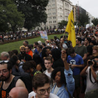"""Demonstrators march near the White House on the one year anniversary of the Charlottesville """"Unite the Right"""" rally, Sunday, Aug. 12, 2018, in Washington. (Jacquelyn Martin/AP)"""