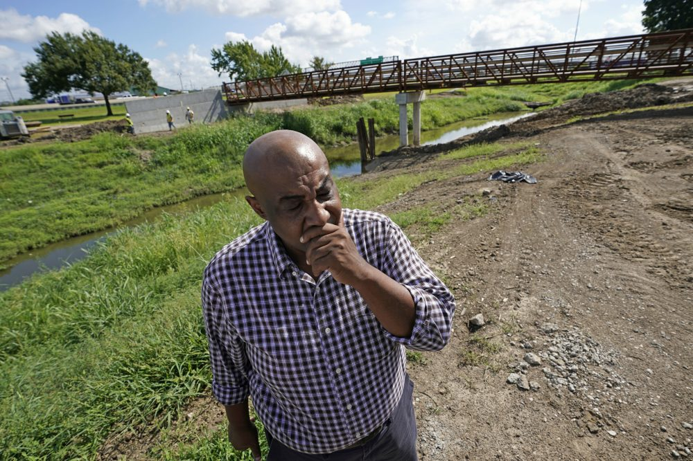 """In this Aug. 9, 2018 photo, Keith Downey pauses as he talks about the flooding Hurricane Harvey caused as he stands near Hunting Bayou in Houston. Before Hurricane Harvey, """"there was a great need here in the community, voids to be filled. So now you are going to put a hurricane on top of this?"""" said Downey, president of the Kashmere Gardens Super Neighborhood, a local community group. (David J. Phillip/AP)"""