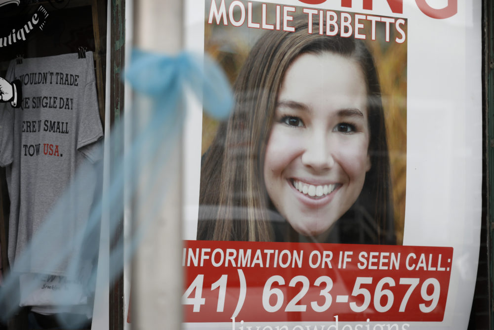 A poster of University of Iowa student Mollie Tibbetts hangs in the window of a local business, Tuesday, Aug. 21, 2018, in Brooklyn, Iowa, the same day authorities found Tibbetts dead. (Charlie Neibergall/AP)