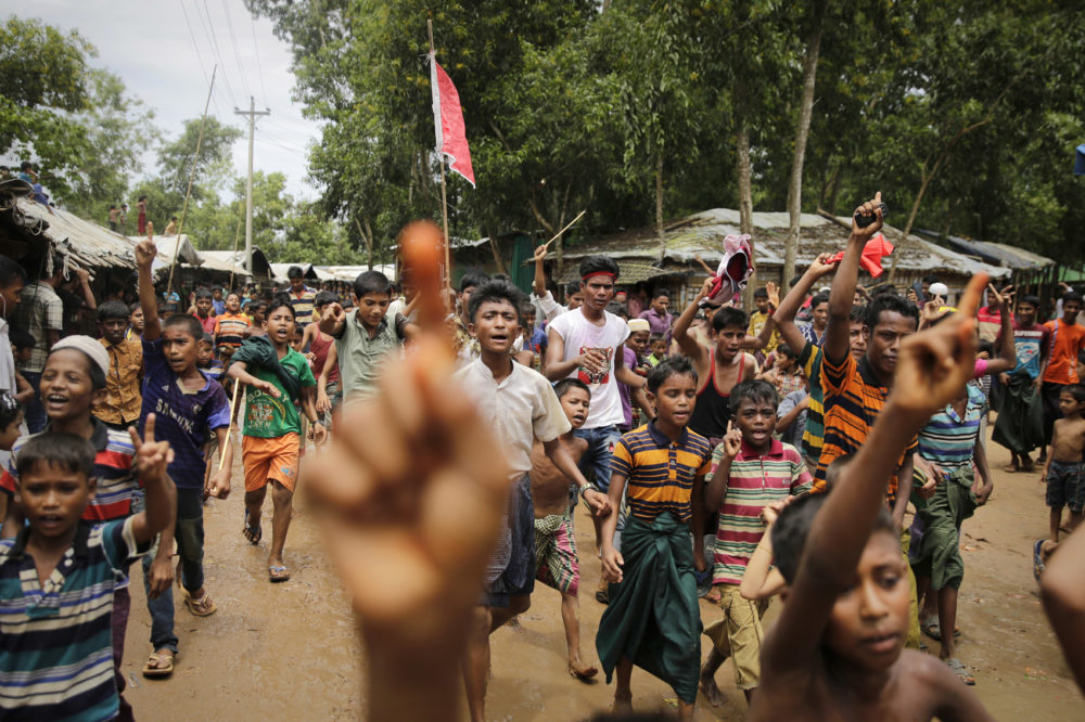 Rohingya refugee boys shout slogans during a protest rally to commemorate the first anniversary of Myanmar army's crackdown which lead to a mass exodus of Rohingya Muslims to Bangladesh, at Kutupalong refugee camp in Bangladesh, Saturday, Aug. 25, 2018. Thousands of Rohingya Muslim refugees on Saturday marked the one-year anniversary of the attacks that sent them fleeing to safety in Bangladesh, praying they can return to their homes in Myanmar and demanding justice for their dead relatives and neighbors. (Altaf Qadri/AP)
