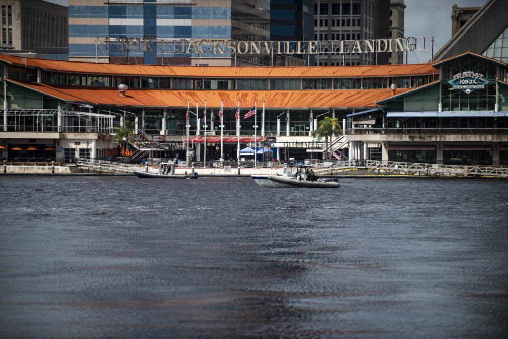 Police patrol the St. Johns River by boat just outside the Jacksonville Landing complex, where there was a shooting Sunday. (Laura Heald/AP)