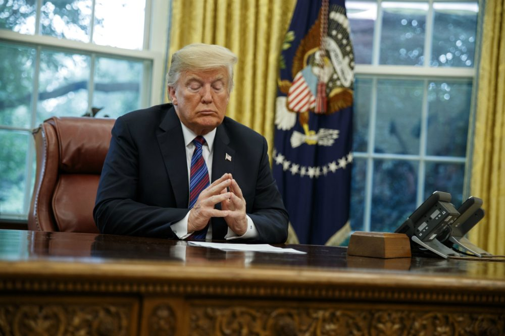 President Donald Trump listens during a phone call with Mexican President Enrique Pena Nieto about a trade agreement between the United States and Mexico, in the Oval Office of the White House, Monday, Aug. 27, 2018, in Washington. (Evan Vucci/AP)