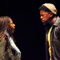 """Sicelo (Atandwa Kani) warns his sister, Noxolo (Alfie Fuller), not to get involved in LGBTQ politics in """"Dangerous House,"""" set in South Africa. (Courtesy Carolyn Brown / Williamstown Theatre Festival)"""