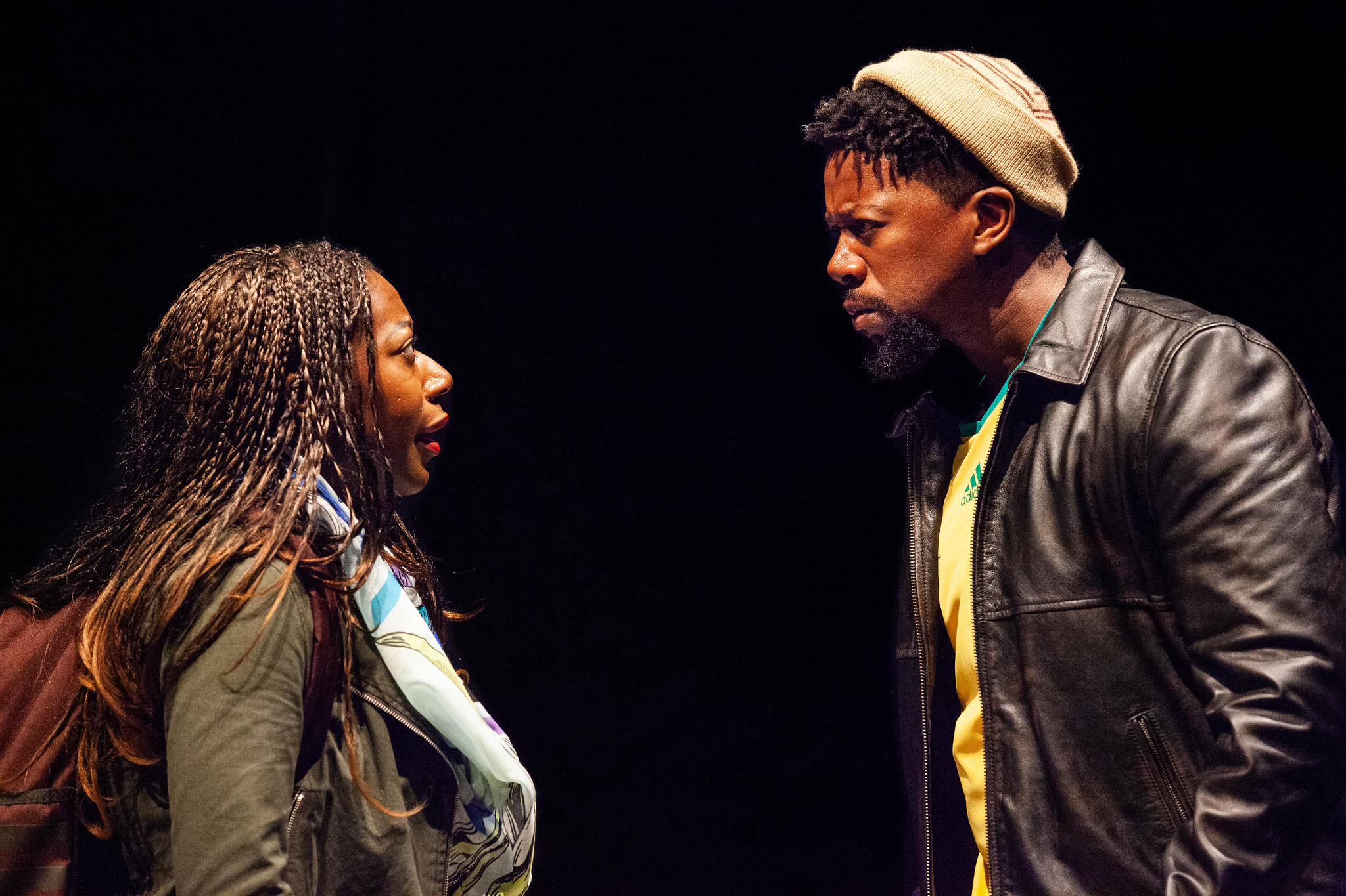 "Sicelo (Atandwa Kani) warns his sister, Noxolo (Alfie Fuller), not to get involved in LGBTQ politics in ""Dangerous House,"" set in South Africa. (Courtesy Carolyn Brown / Williamstown Theatre Festival)"