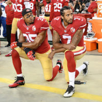 Colin Kaepernick and Eric Reid of the San Francisco 49ers kneel in protest during the national anthem prior to a game against the Los Angeles Rams on September 12, 2016.  (Thearon W. Henderson/Getty Images)