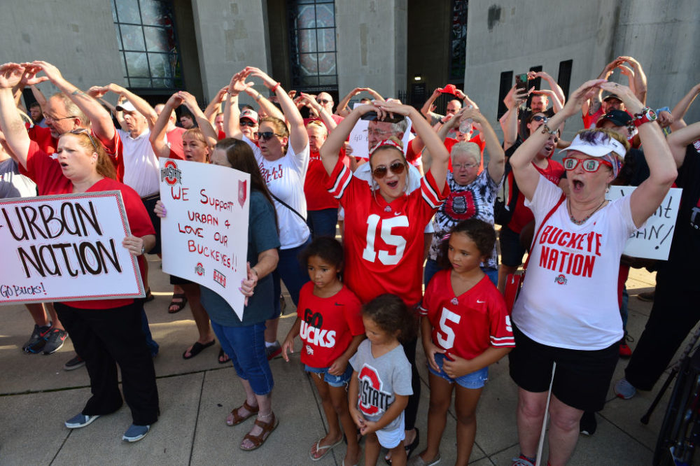 Supporters of Ohio State head football coach Urban Meyer sing Carmen Ohio at an August 6th rally in Columbus, Ohio. (Jamie Sabau/Getty Images)