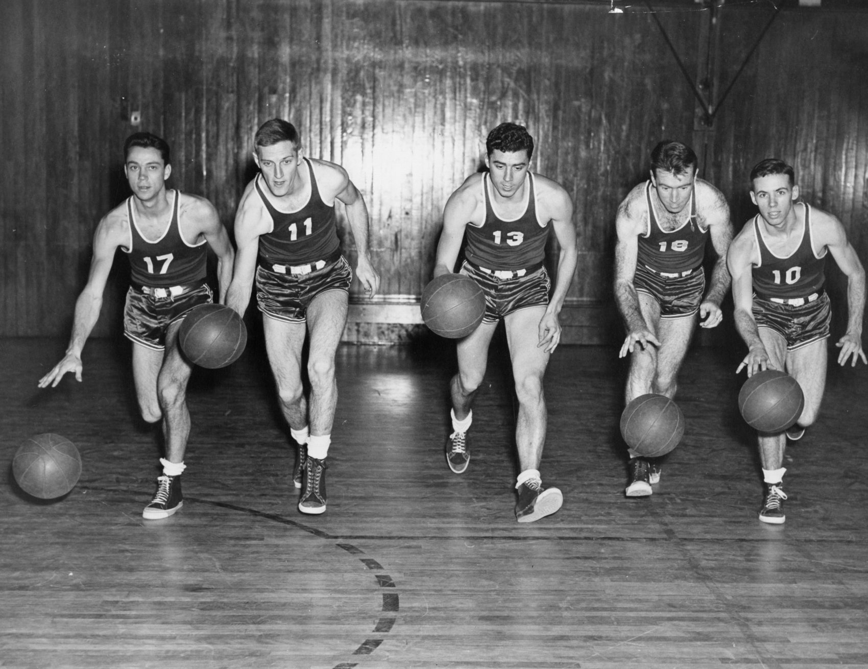 On March 6, 1950, the basketball team at St. Lawrence University took on the NBA's Syracuse Nationals. (From left to right: John Lawrence, Warren Elmslie, John Moro, Bill O'Rourke and Roger Lawrence.) (St. Lawrence University Archives)