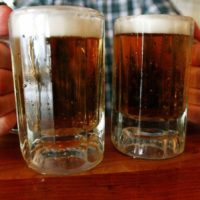 A bartender serves two mugs of beer at a tavern in Montpelier, Vermont. (Toby Talbot/AP)