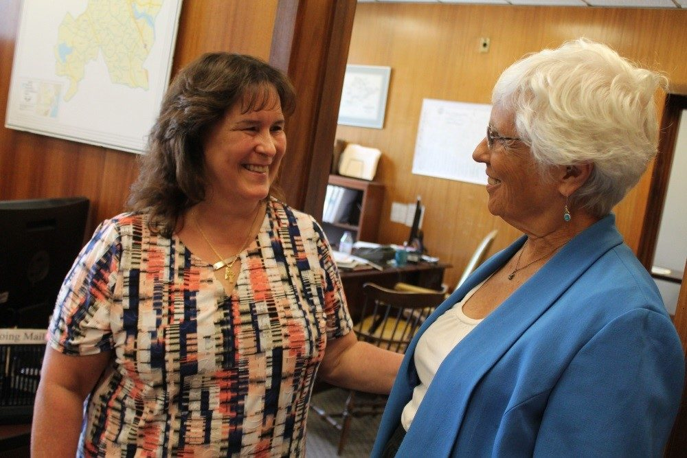 Bernadette Coughlin talked with Sen. Pat Jehlen, co-chairwoman of the Joint Marijuana Policy Committee, on Tuesday in Jehlen's State House office. (Sam Doran/SHNS)