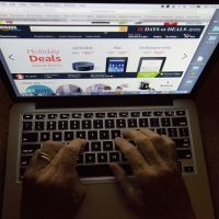In this Monday, Dec. 12, 2016, photo, an online shopper searches a site, while logged in from Miami. (Wilfredo Lee/AP)