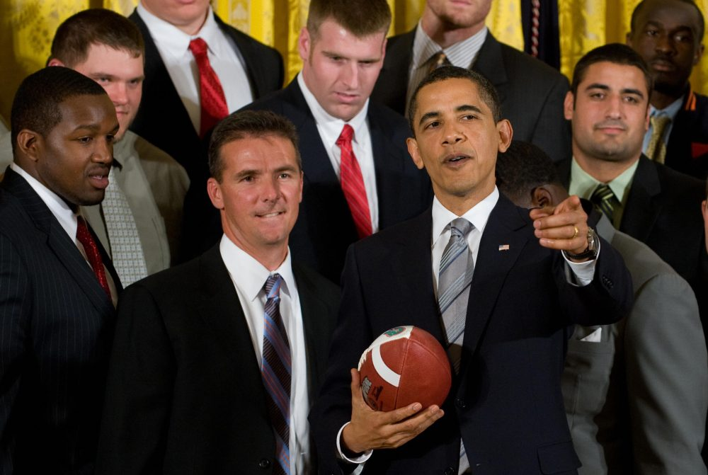 Urban Meyer, now Ohio State's head football coach, stands alongside Barack Obama during a ceremony honoring the NCAA champion Florida Gators in 2009. (Saul Loeb/AFP/Getty Images)