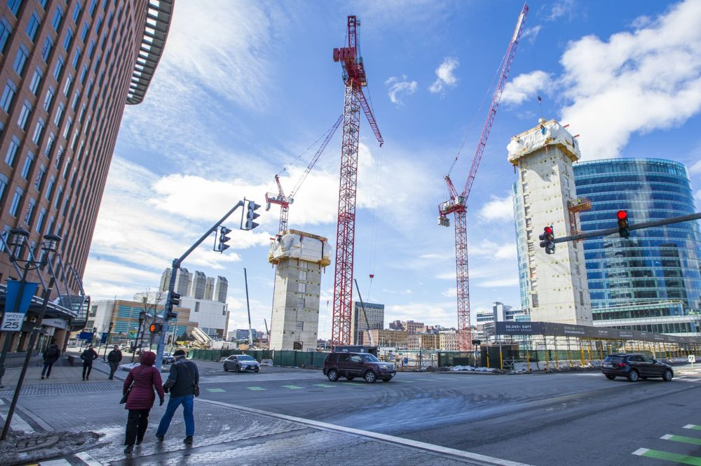Cranes stretch into the sky over what will become three-buildings of luxury apartments and condominiums, the Echelon Seaport. (Jesse Costa/WBUR)