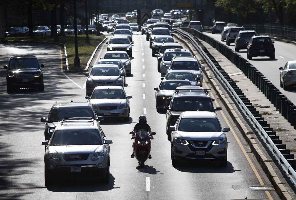 In the heat of the late afternoon, cars crawl along Storrow Drive. (Robin Lubbock/WBUR)