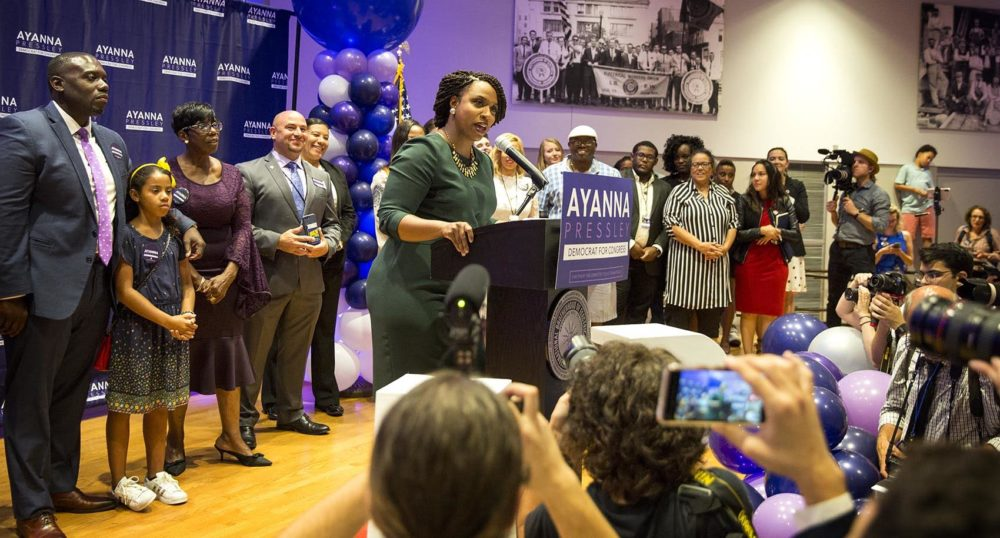 Ayanna Pressley talks to supporters celebrating her victory in the 7th district primary election. (Robin Lubbock/WBUR)