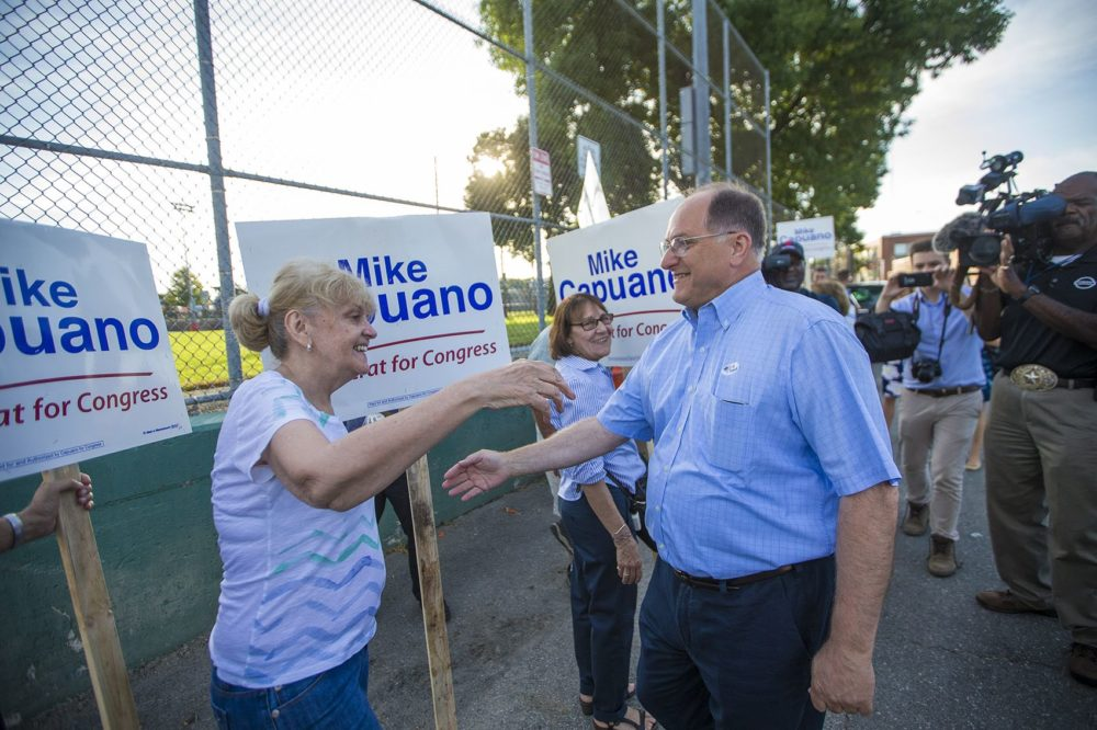 U.S. Rep. Michael Capuano greets supporters outside of Trum Field in Somerville after he voted. (Jesse Costa/WBUR)