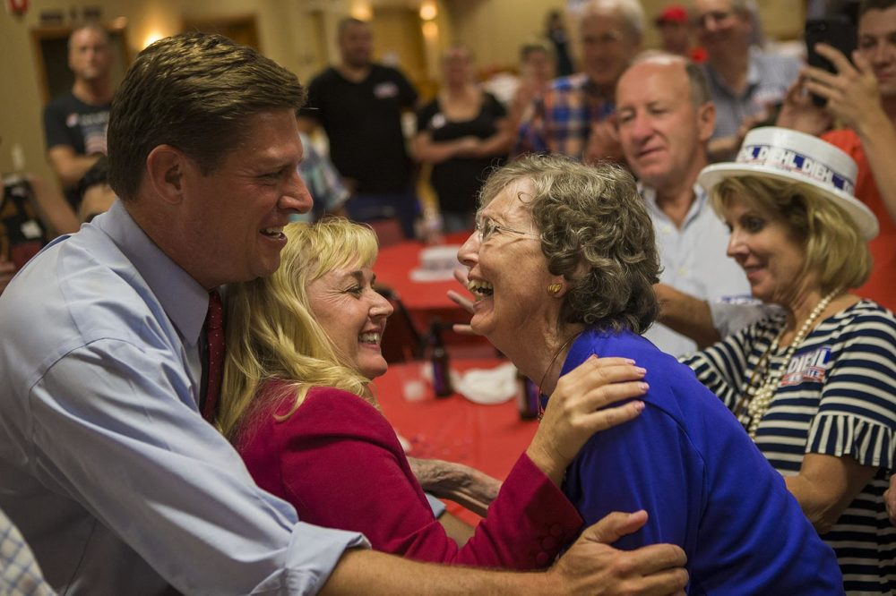 Geoff Diehl and his wife KathyJo Boss, center, greet a supporter after his Republican U.S. Senate primary win. (Jesse Costa/WBUR)