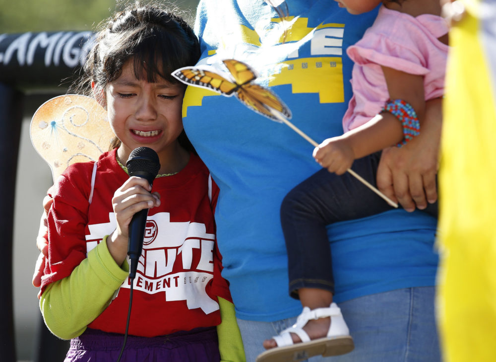 Akemi Vargas, 8, cries as she talks about being separated from her father at the border during an immigration family separation protest in front of the Sandra Day O'Connor U.S. District Court building on June 18 in Phoenix. (Ross D. Franklin/AP)