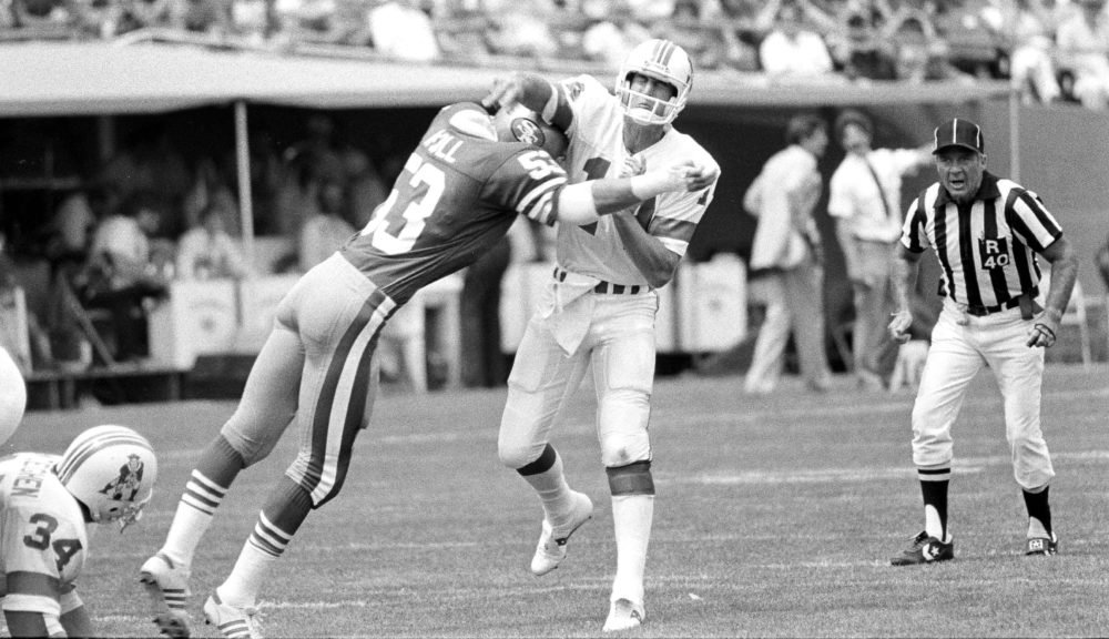 Milt McColl (left) attended medical school while playing in the NFL. (Paul Sakuma/AP)