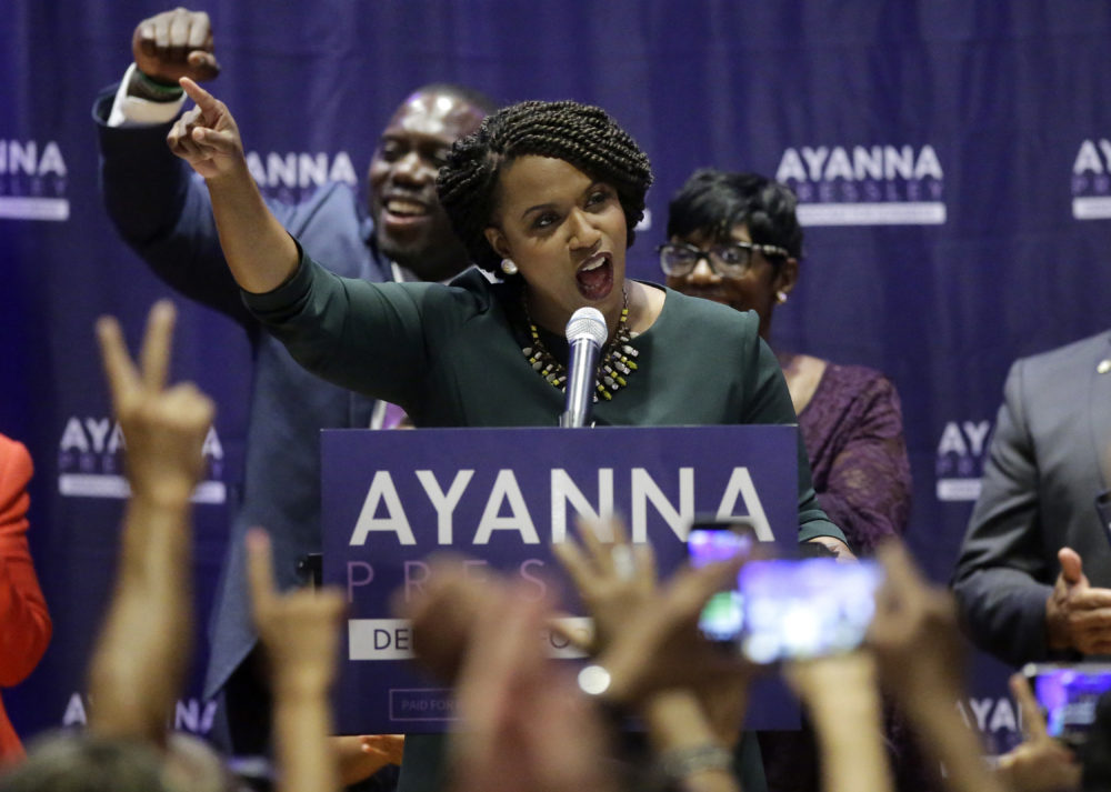 Boston City Councilor Ayanna Pressley, center, celebrates victory over U.S. Rep. Michael Capuano, D-Mass., in the 7th Congressional House Democratic primary on Tuesday. (Steven Senne/AP)