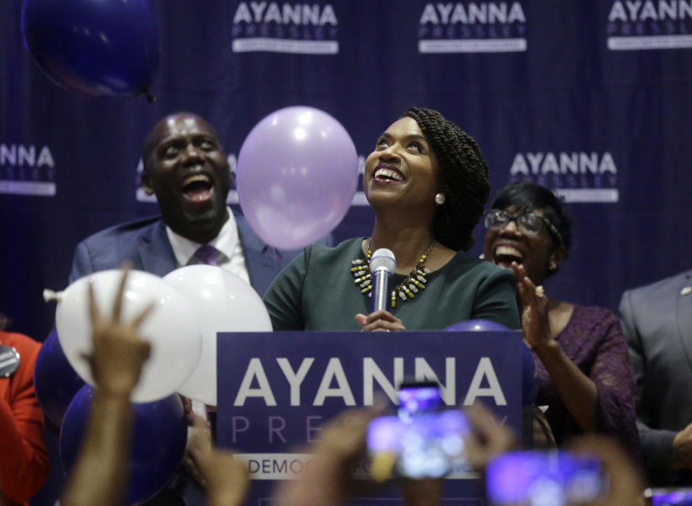 Boston City Councilor Ayanna Pressley, center, celebrates victory over U.S. Rep. Michael Capuano, D-Mass., in the 7th Congressional House Democratic primary, Tuesday, Sept. 4, 2018, in Boston. (Steven Senne/AP)