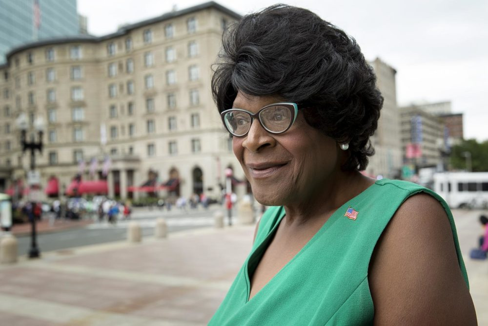 Althea Garrison, who is next in line for Ayanna Pressley's at-large Boston City Council seat, speaks outside Boston Public Library. (Robin Lubbock/WBUR)