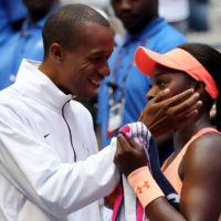 Kamau Murray (left) coaches Sloane Stephens — but that's not his only job. (Elsa/Getty Images)