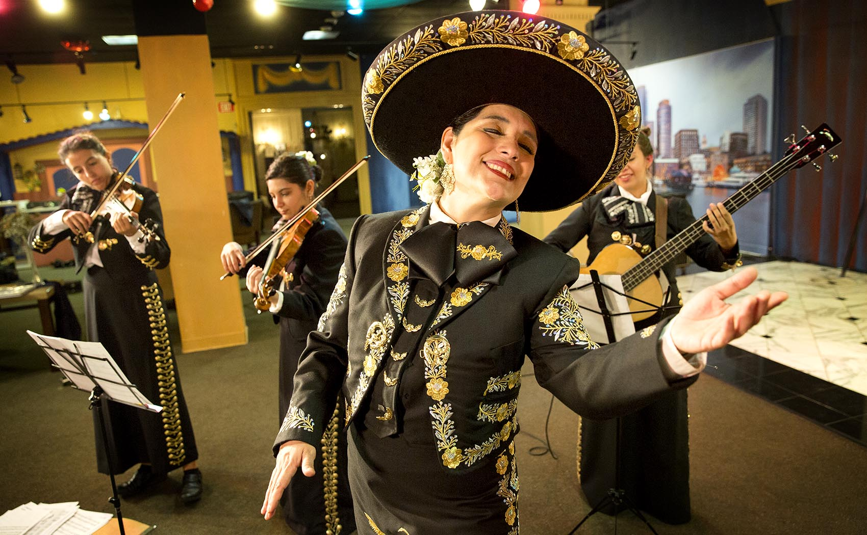Veronica Robles rehearsing with her mariachi band in East Boston. (Robin Lubbock/WBUR)