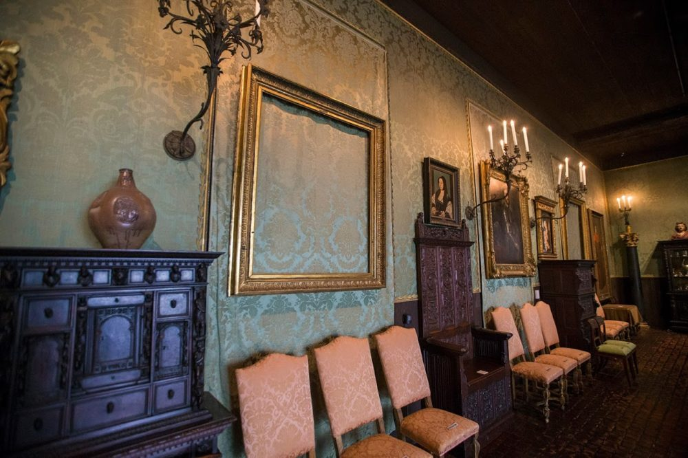 "The back wall of the Dutch Room where the empty frames of two Rembrandt paintings hang; ""Lady and Gentleman in Black,"" front, and ""Christ in the Storm on the Sea of Galilee."" (Jesse Costa/WBUR)"