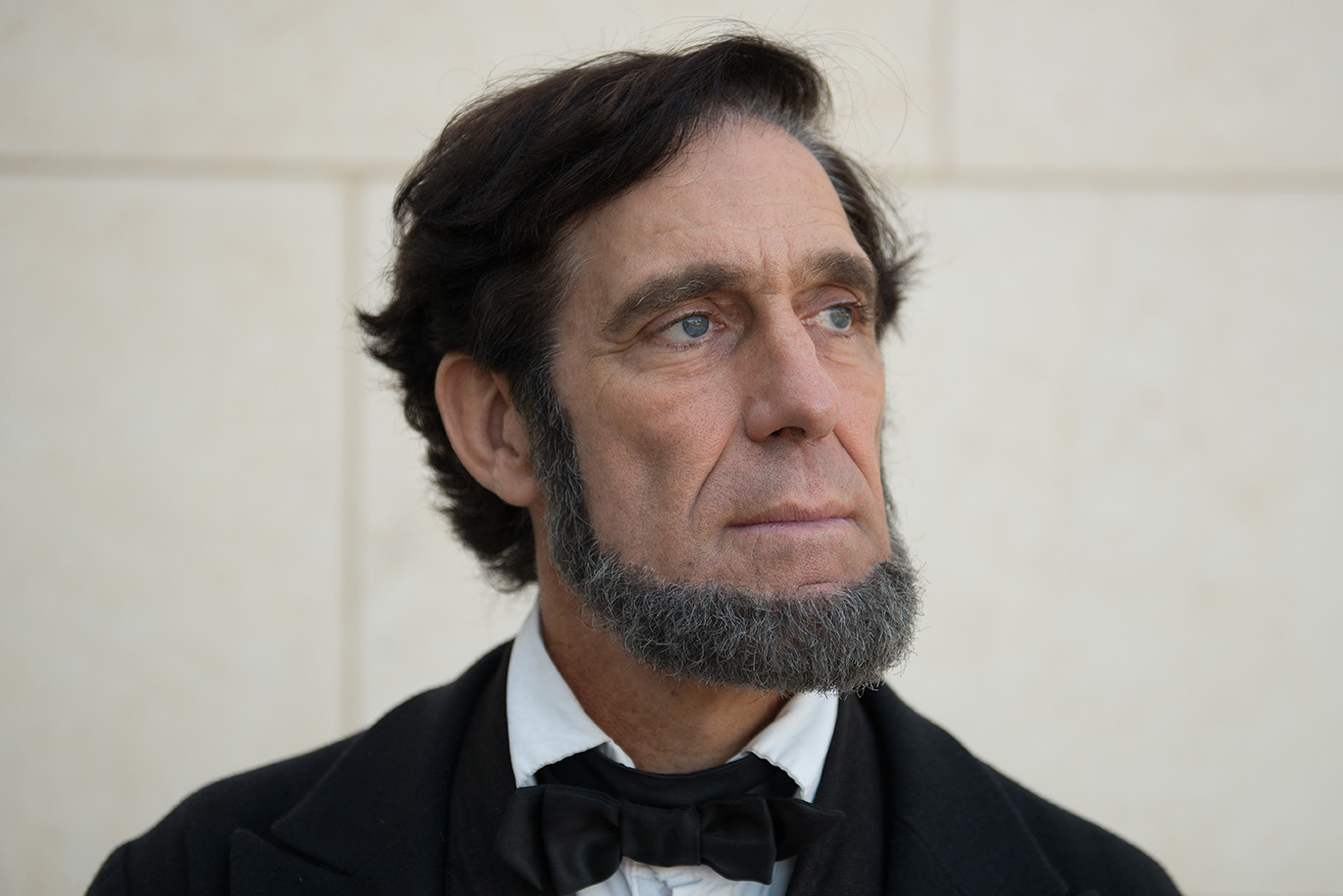 Randy Duncan, an Abraham Lincoln impersonator, poses for a portrait outside the Abraham Lincoln Presidential Library, Monday, Sept. 10, 2018, in Springfield, Ill. (Neeta Satam for Here & Now)