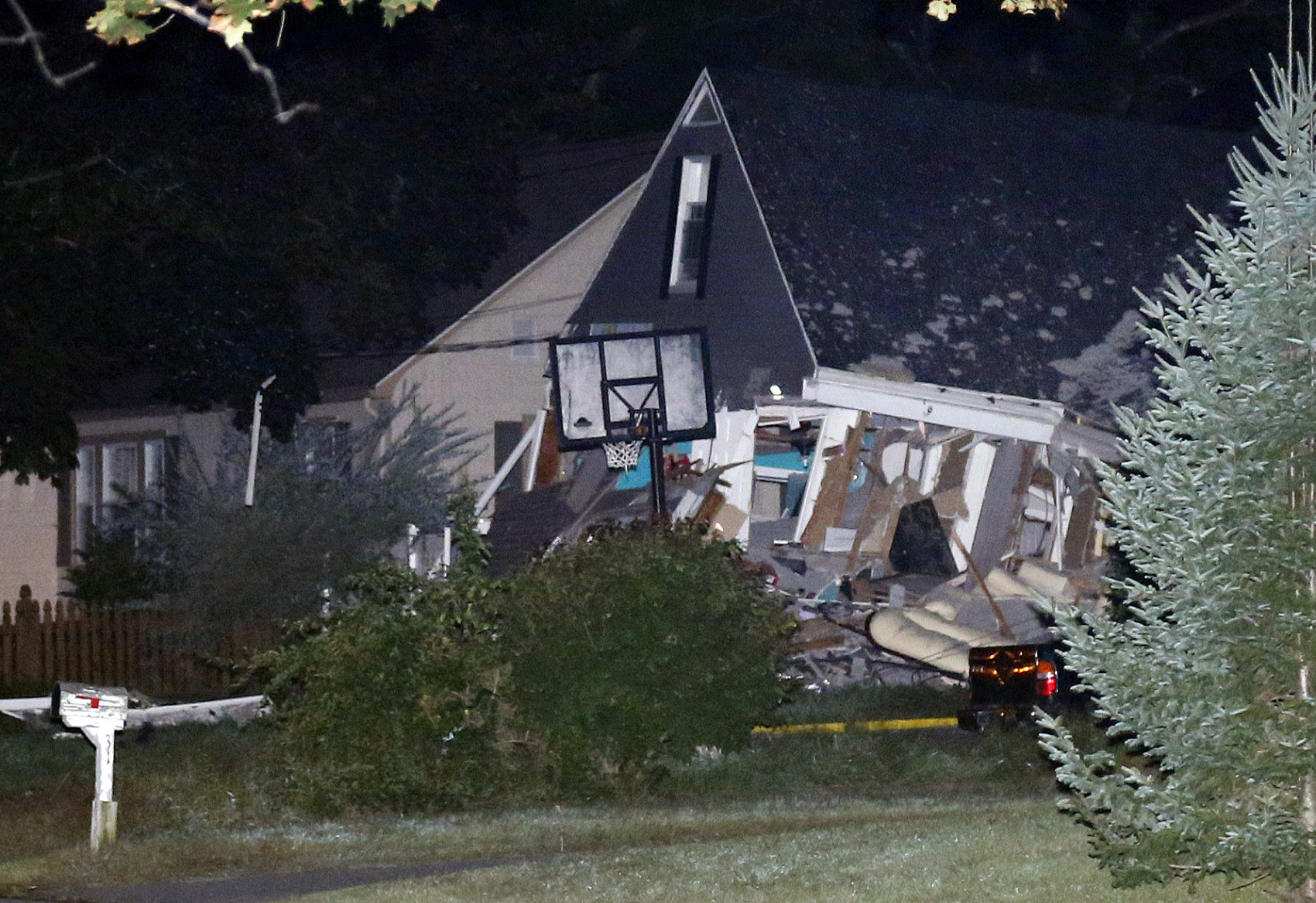 A house is destroyed in Lawrence, Massachusetts, on Sept. 13, 2018. A problem with a gas line that feeds homes in several communities north of Boston triggered a series of gas explosions and fires. (AP Photo/Mary Schwalm)