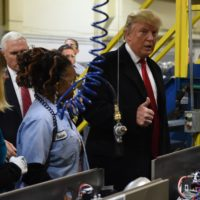 President-elect Donald Trump (right) and Vice President-elect Gov. Mike Pence visit the Carrier air conditioning and heating company in Indianapolis on Dec. 1, 2016. (Timothy A. Clary/AFP/Getty Images)