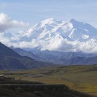 In this photo taken Aug. 26, 2016, sightseeing buses and tourists are seen at a pullout popular for taking in views of North America's tallest peak, Denali, in Denali National Park and Preserve, Alaska. (Becky Bohrer/AP)