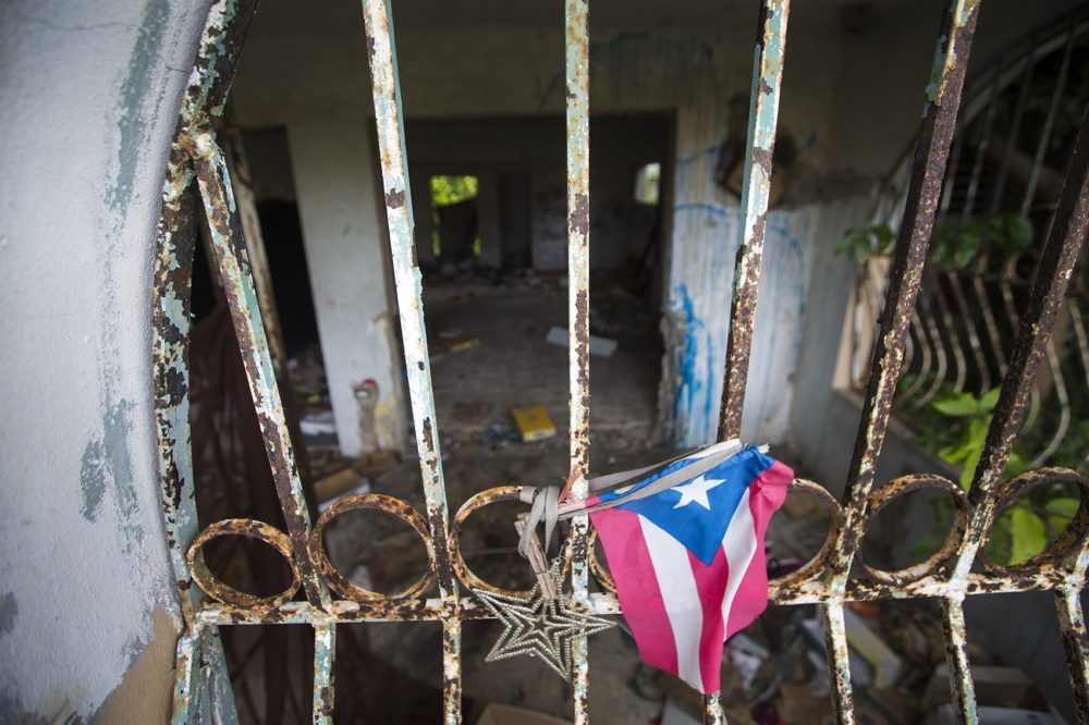 An abandoned house in Barrio-Bravos De Boston in Cantera, San Juan, left by the owners due to the prolonged wait to restore electricity in the area after Hurricane Maria. The house was then possessed by drug users for a time before local residents drove them out and now has plans to clean it up. (Jesse Costa/WBUR)