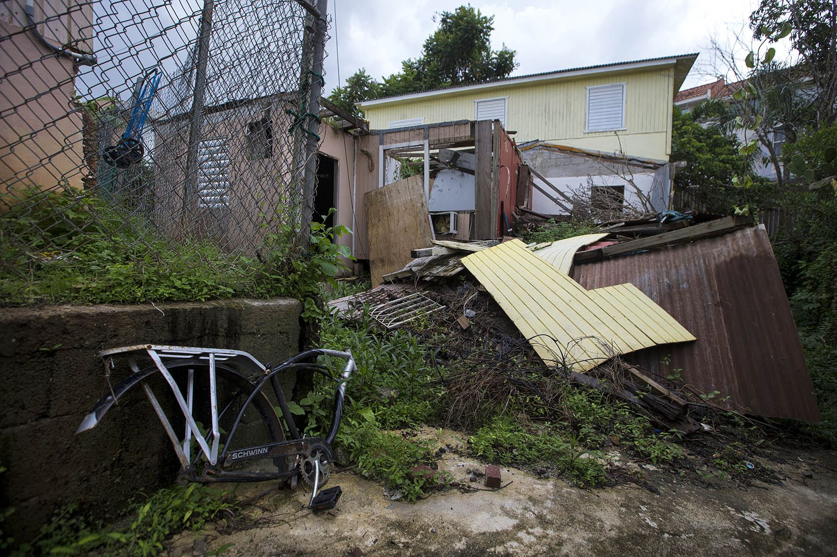 A house in Guaynabo, which was completely leveled by Hurricane Maria, still sits in ruin one year after the storm. (Jesse Costa/WBUR)