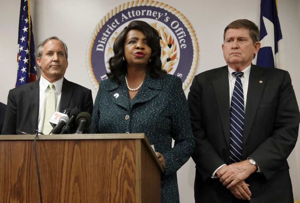 Texas Attorney General Ken Paxton, from left, Dallas County District Attorney Faith Johnson, center, and 1st Dallas County Assistant District Attorney Mike Snipes, right, address the media during a news conference, June 22, 2017, in Dallas. (Tony Gutierrez/AP)