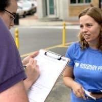 Roslindale resident and planner Rachel Young canvasses for Roxbury Prep. (Max Larkin/WBUR)