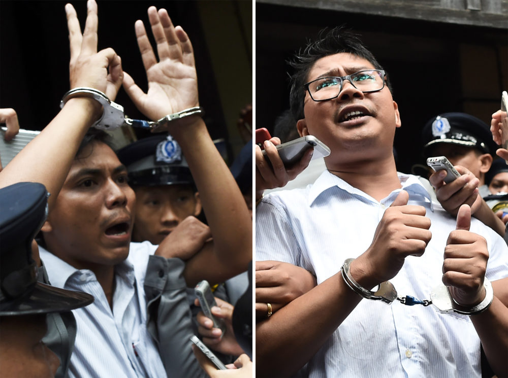 This combo shows journalists Kyaw Soe Oo (left) and Wa Lone (right) being escorted by police after their sentencing by a court to jail in Yangon on Sept. 3, 2018. (Ye Aung Thu/AFP/Getty Images)