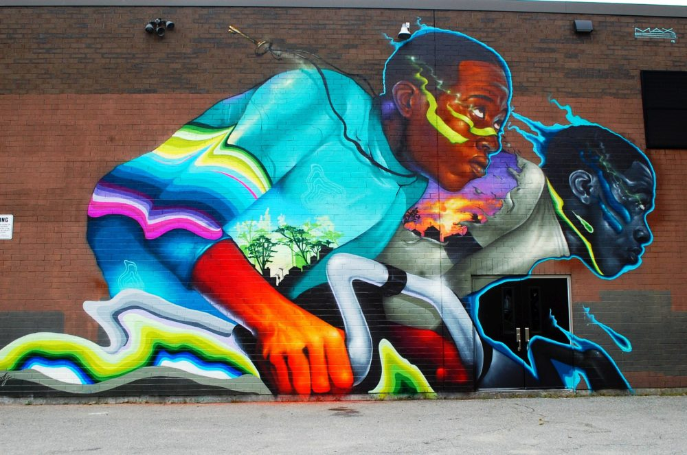 "Max Sansing's mural in Worcester honors American track cyclist Marshall Walter ""Major"" Taylor. (Dana Forsythe for WBUR)"