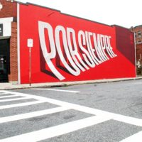 "Artist Ben Johnston's ""Por Siempre"" mural in Worcester (Dana Forsythe for WBUR)"