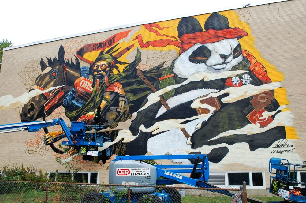 Dragon76 and Woes Martin's mural in Worcester. (Dana Forsythe for WBUR)