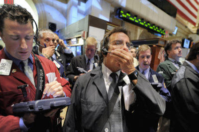 Traders work on the New York Stock Exchange floor, Monday Oct. 6, 2008. Wall Street tumbled again Monday, joining a sell-off around the world as fears grew that the financial crisis will cascade through economies globally despite bailout efforts by the U.S. and other governments. (AP Photo/Richard Drew)