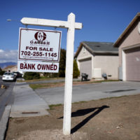 FILE - In this file photo taken Feb. 18, 2009, a for sale sign stands outside a bank-owned home in North Las Vegas. (AP Photo/Jae C. Hong, File)