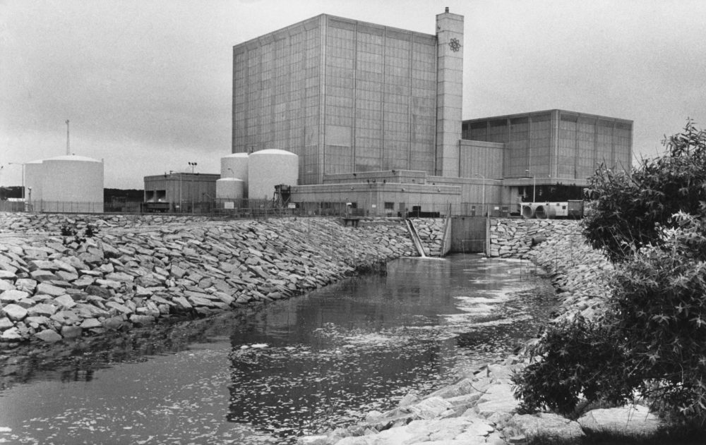 This July 12, 1979 file photo shows the Pilgrim nuclear power plant in Plymouth, Massachusetts. Federal regulators are reviewing plans by the owner of the plant to sell the facility after it stops producing power next year. (AP Photo/Tannen Maury)