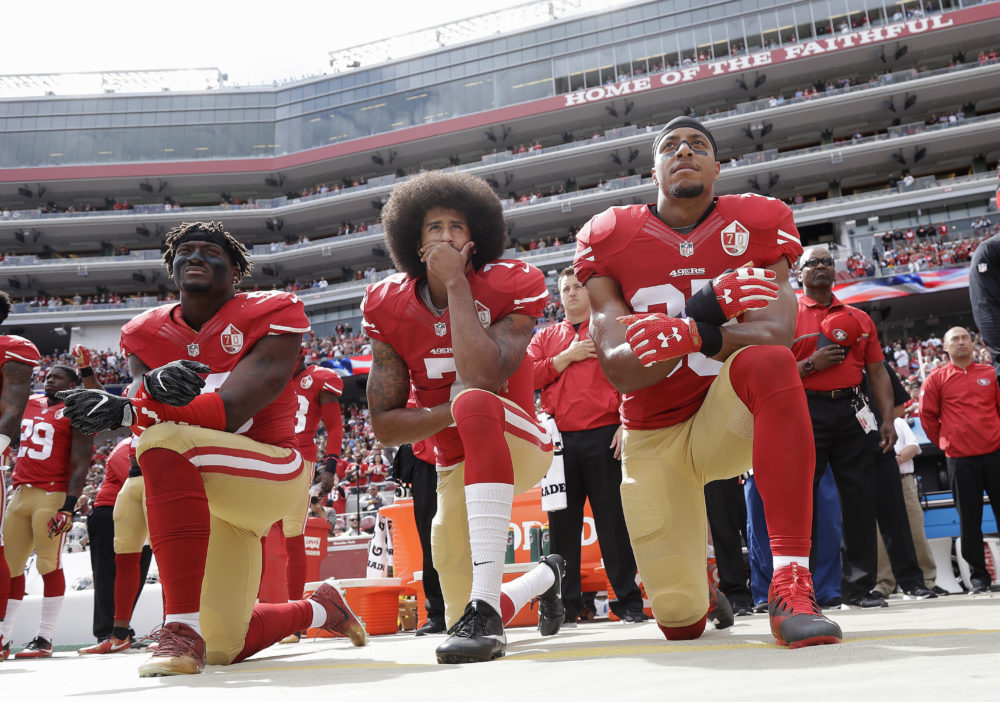San Francisco 49ers outside linebacker Eli Harold, left, quarterback Colin Kaepernick, center, and safety Eric Reid kneel during the national anthem before an NFL football game against the Dallas Cowboys in Santa Clara, Calif., Sunday, Oct. 2, 2016. (Marcio Jose Sanchez/AP)