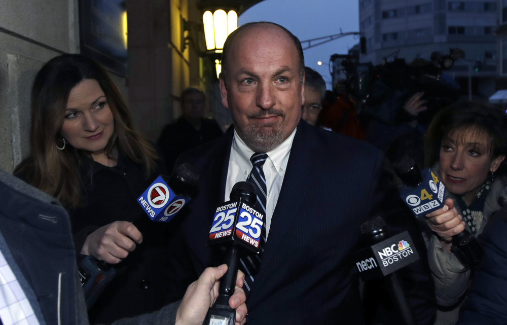 Former state Sen. Brian Joyce is surrounded by reporters as he leaves the federal courthouse in Worcester on Dec. 8, 2017. (Charles Krupa/AP)
