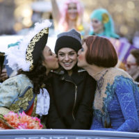 Actress Mila Kunis is kissed by actors dressed in drag during the Hasty Pudding Parade in January 2018. (Charles Krupa/AP)