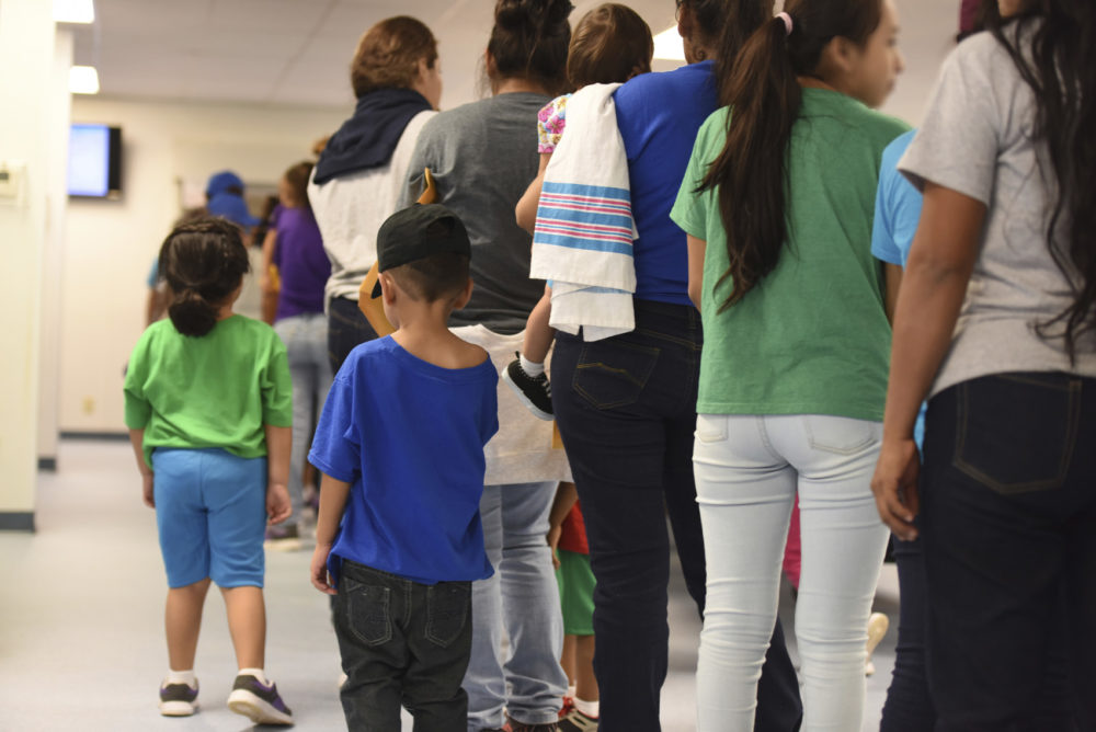 "In this Thursday, Aug. 9, 2018, photo, provided by U.S. Immigration and Customs Enforcement, mothers and their children stand in line at South Texas Family Residential Center in Dilley, Texas. Currently housing 1,520 mothers and their children, about 10 percent are families who were temporarily separated and then reunited under a ""zero tolerance policy"" that has since been reversed. (Charles Reed/U.S. Immigration and Customs Enforcement via AP)"