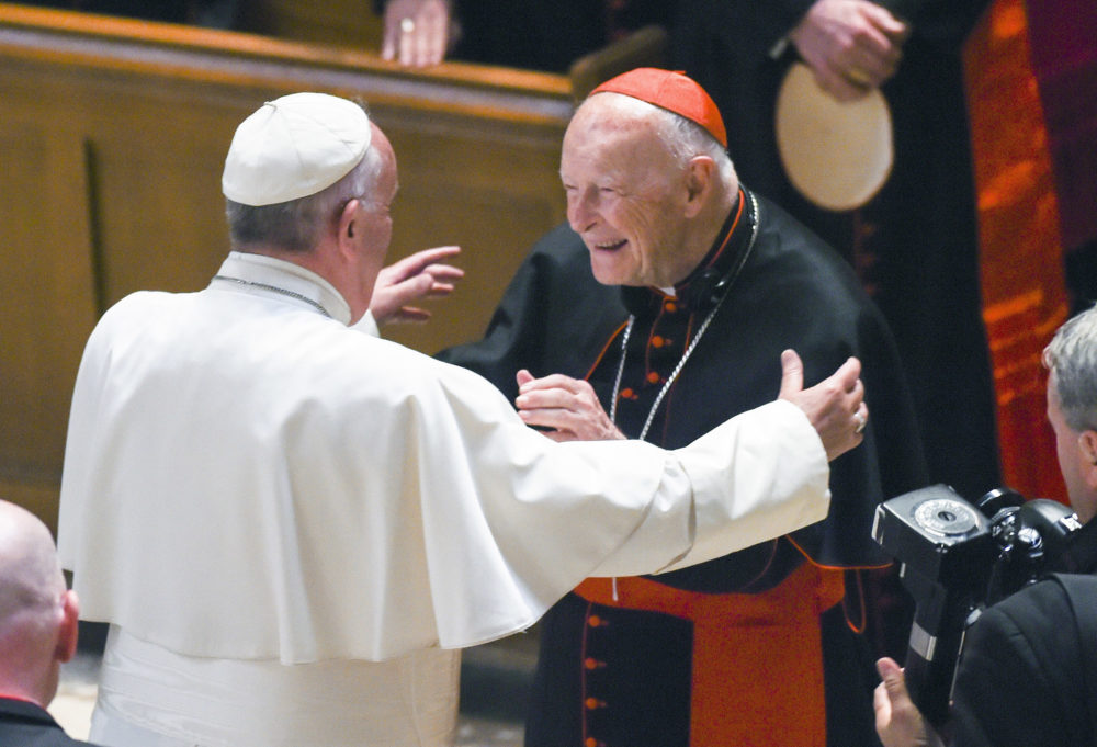 In this Sept. 23, 2015 file photo, Pope Francis reaches out to hug Cardinal Archbishop emeritus Theodore McCarrick at the Cathedral of St. Matthew the Apostle in Washington. (Jonathan Newton/The Washington Post via AP, Pool, File)